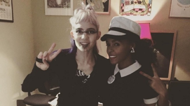 """Watch Grimes and Janelle Monae Wield Flaming Swords in Teaser for """"Venus Fly"""" Music Video"""
