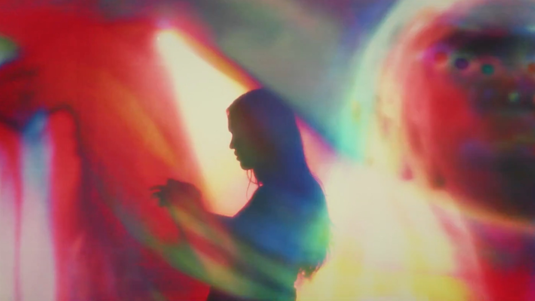 "Marie Davidson Sways Through a Neon Discotheque in ""Adieu Au Dancefloor"" Video"